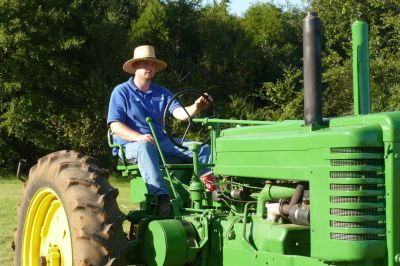 Matt Calahan on a tractor (rare photo)